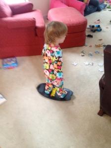 Doing work on her balance board. Thanks' Kraslawsky's!