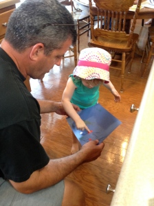 Explaining her father's day card for daddy.